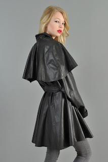 Vintage 1980's black leather mini trench dress with cape top and button up belt front closure.