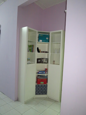 Corner bookcase is the best solution for tricky space ! =)