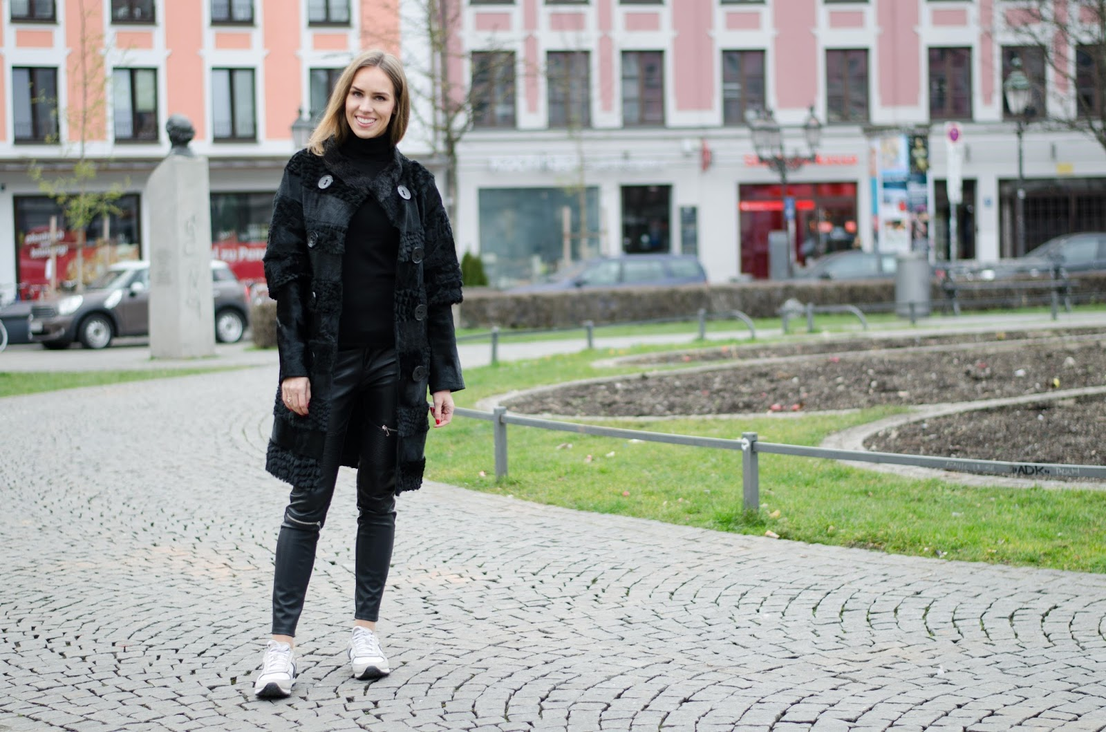 kristjaana mere all black winter outfit with fur coat leather pants sneakers