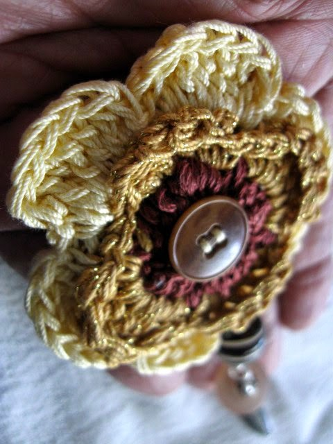 https://www.etsy.com/listing/194396501/crochet-beaded-button-brooch-yellow?ref=shop_home_active_1