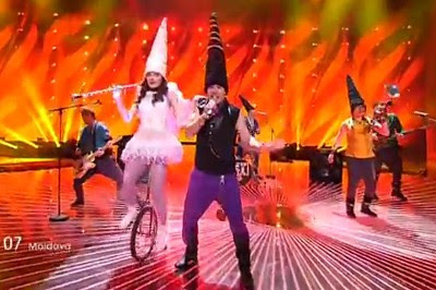 Moldova: A band wearing black conehats, plus a fairy on a unicycle