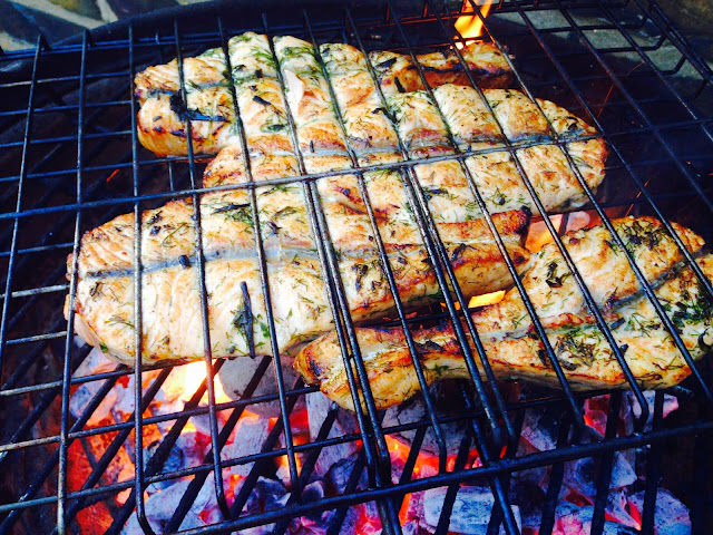 Butterflied salmon fillets on BBQ