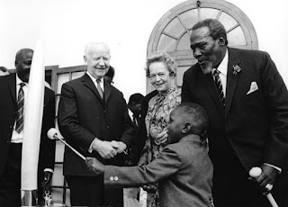 Uhuru Muigai Kenyatta his father