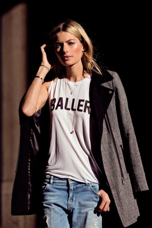 Jessica Hart boyfriend jeans + baller tee via thepursuitaesthetic