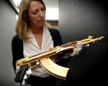 gold plated custom made expensive assault rifle picture at auction