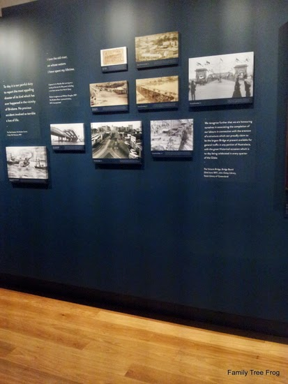 Part of display in The River - A History of Brisbane Exhibition - 9 mounted photos and text on slate blue coloured wall