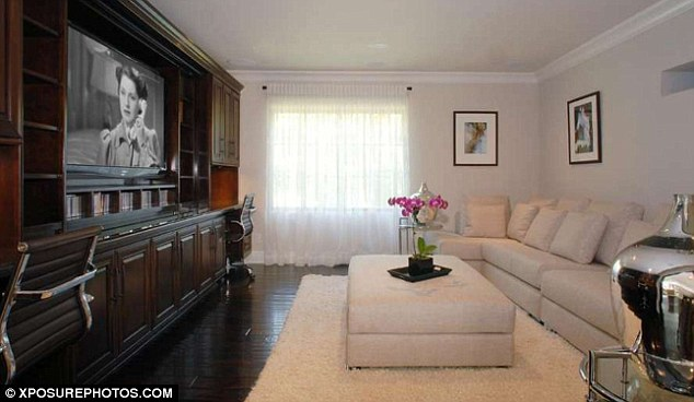 Picture of living room with big screen tv