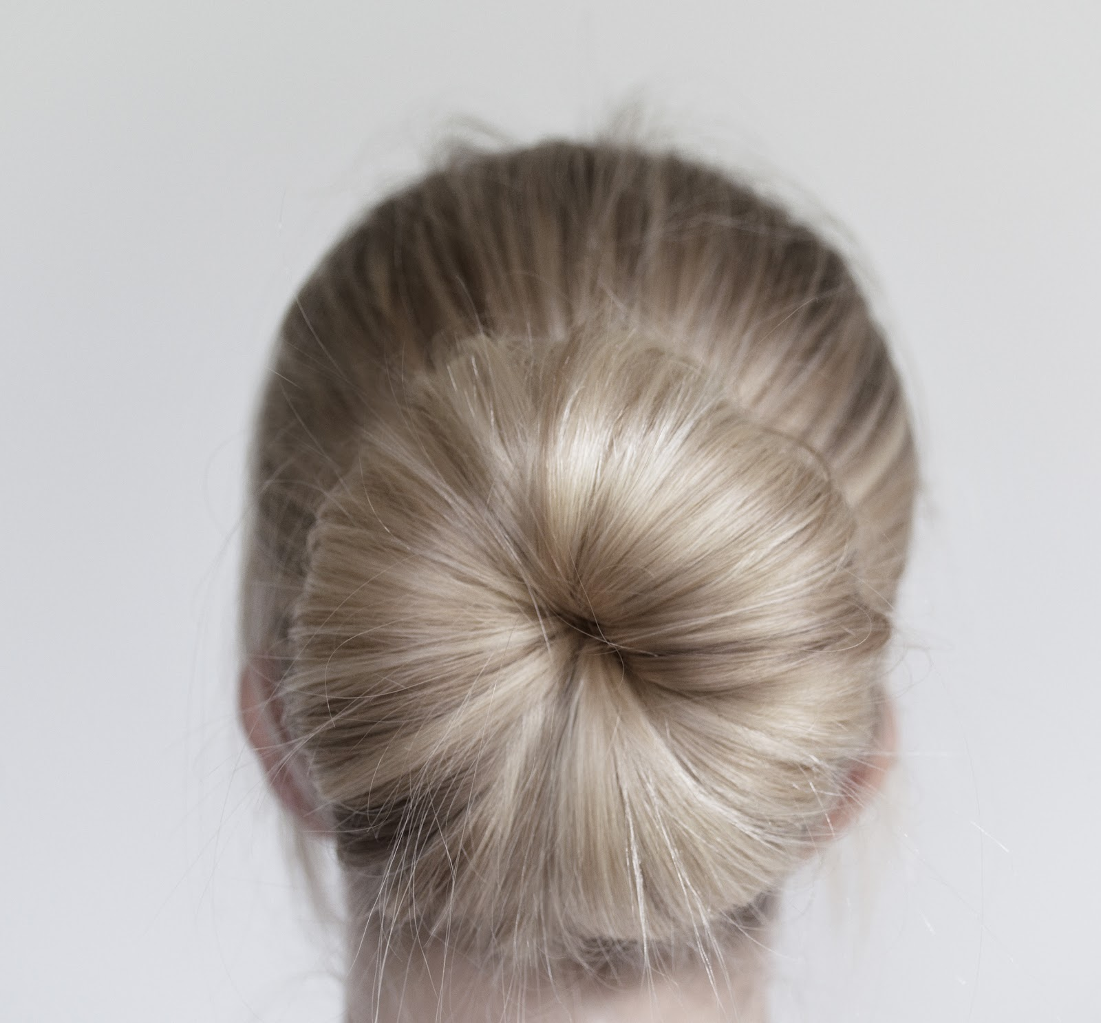How many ways can you style a donut bun? A lovely reader Mili asked for some new ideas for wearing a donut bun. She describes her hair as shoulder length and thin and would love to know more interesting ways to style her donut bun. Well, it's no secret I'm a big fan of bun hairstyles. If you.