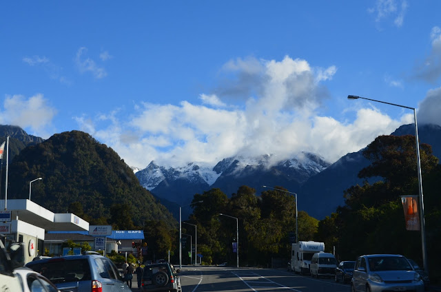 The one-street town of Fox Glacier, with Mt. Cook and Mt. Tasman in the distance.