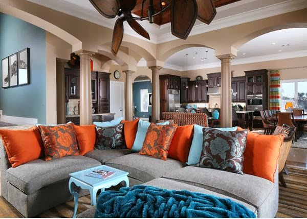 Awesome Arrangement Of Pillows With Attractive Patterns Paired With Plain Cushions,  All In Orange And Blue. Ceiling Decoration Serves As A Useful Brown Accents  To ... Part 5