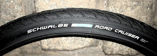 Side view of Schwalbe Road Cruiser 26x1.75 bicycle tire showing manufacturer logos and text