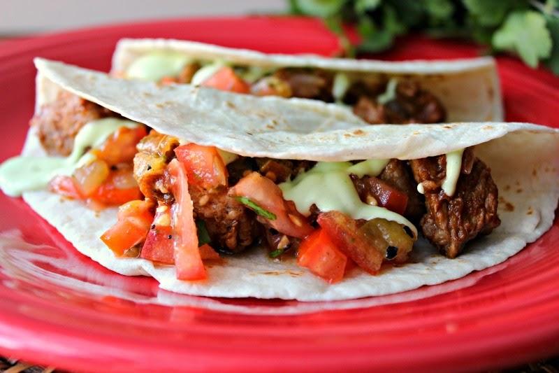 Pork Tacos with Cilantro-Avocado Cream Sauce:  Delicious alternative to plain tacos!  #Mexican #tacos