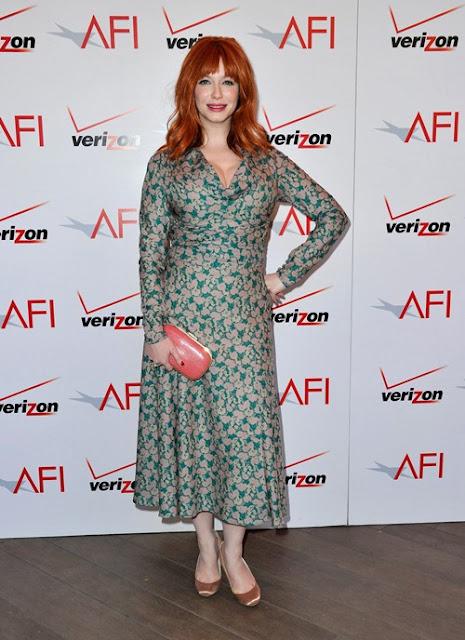 Actress Christina Hendricks in long floral print dress