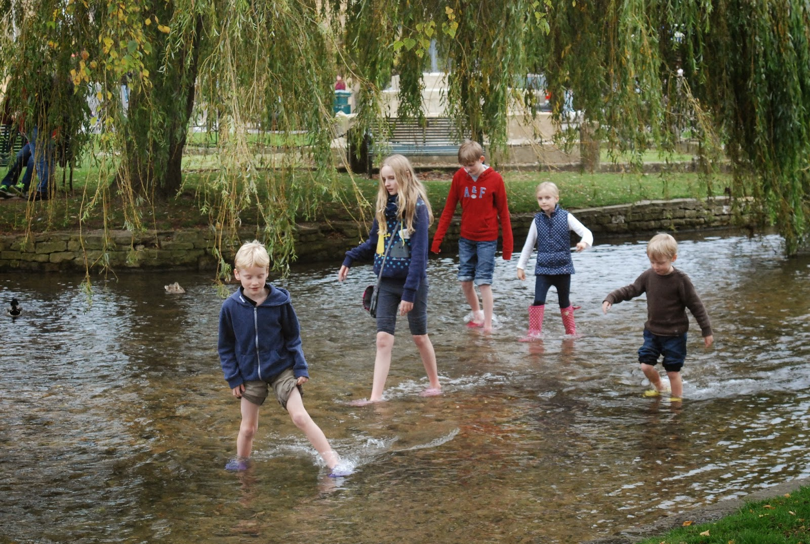 paddling in the river at Bourton-in-the-Water, Cotswolds