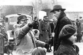 "Director Steven Spielberg and Liam Neeson on the set of ""Schindler's List"""