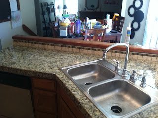 Santa Cellia Granite With Stacked Stone Backsplash