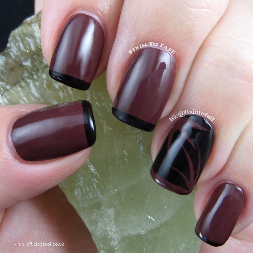 Brown and black skinny French tip nail art design.