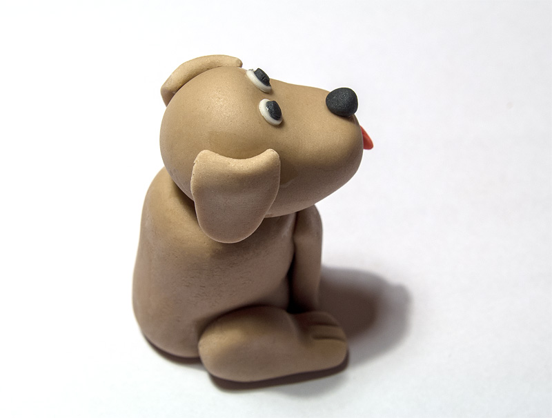 Dog fondant figurine ears on head