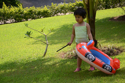 Kecil and her float in the garden