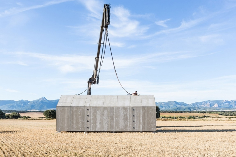 Portable home being placed in the field