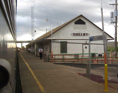 Classic train station with hand-painted sign reading SHELBY