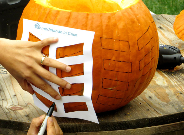 carving a pumpkin for halloween