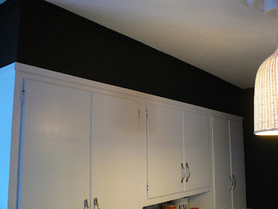 mylittlehousedesign.com black walls with white kitchen cabinets