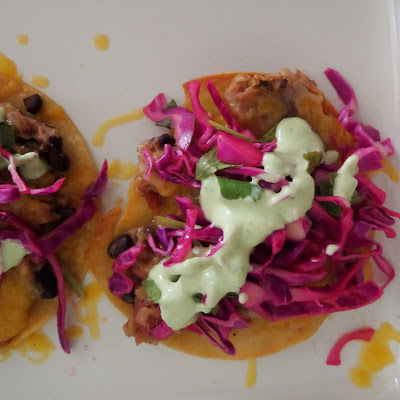 Beans and Rice Tostadas:  Crispy baked corn tortillas topped with beans and rice, cheese, and other toppings.