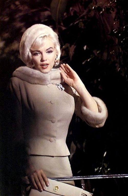 Marilyn Monroe wears a Jean Louis beige wool suit with mink trim and beret