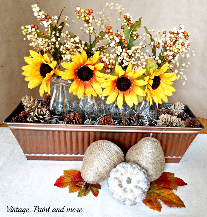 Vintage, Paint and more... vintage centerpiece of sunflowers in milk bottles and bronze trough