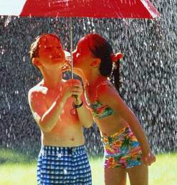 two children playing in the rain
