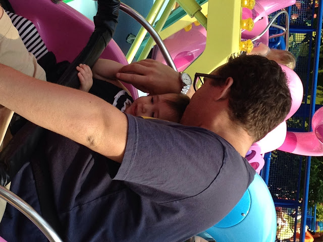 man and child on a ride at mall of america