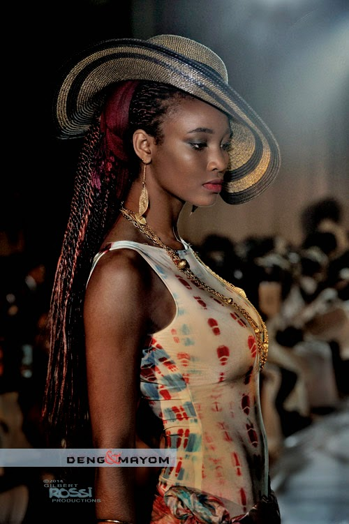 African Fashion Parade by D&M designers, shot by Italian photographer Gilbert Rossi, black model on runway,