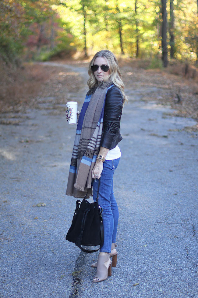 black leather jacket, stripe scarf, current elliot jeans, vince booties, bucket bag