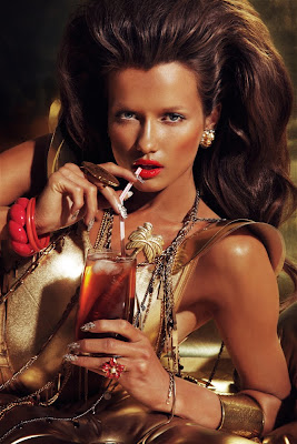woman drinking tropical cocktail, woman with huge hair, barbarella fashion shoot