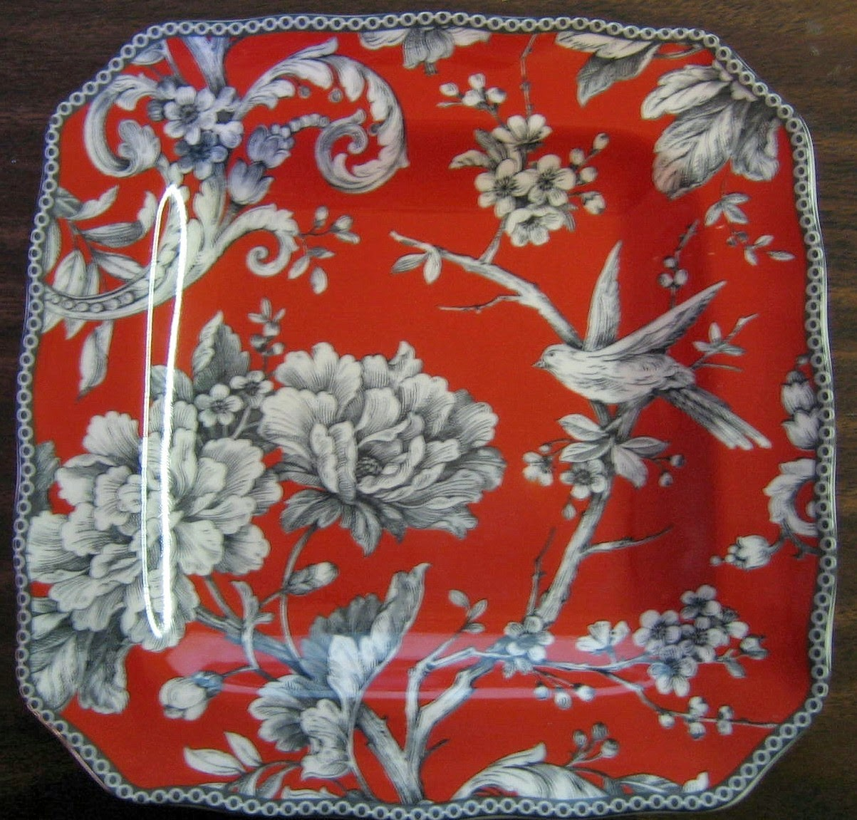 http://www.decorativedishes.net/decorative-plate-3-d-red-black-rose-bird-branch-blossom-square-medium-size/