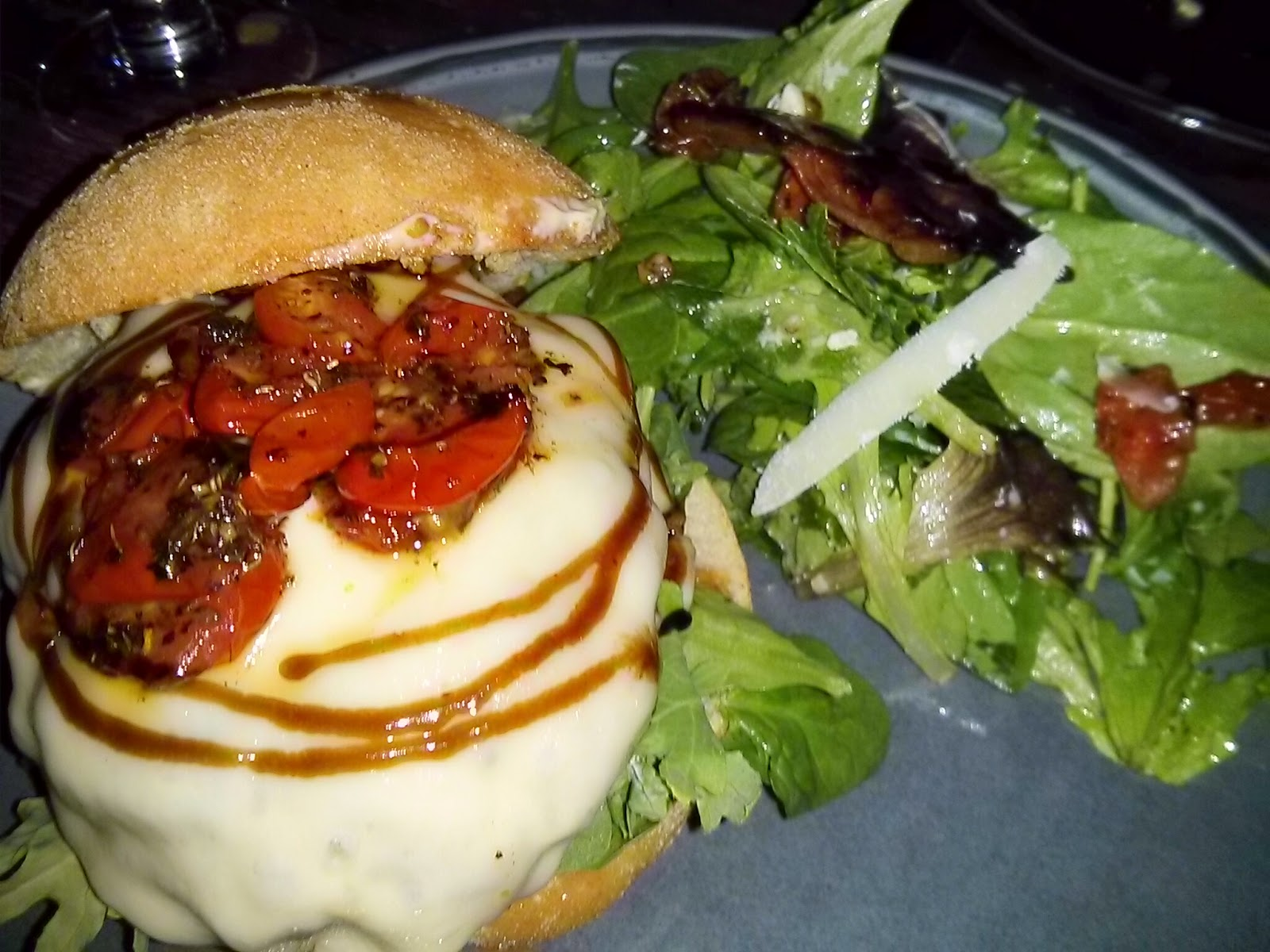 ... Burger: Oven-dried tomatoes, caramelized onions, and lemon caper mayo