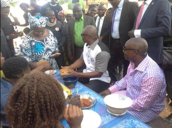 Governor Fayose Pictured Drinking Palmwine With Ekiti Residents At A Local Joint