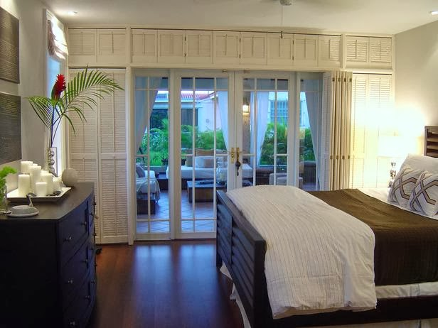 Cabana Style Bedroom : Shuttered Doors And A Private Patio Turns This  Bedroom Into Your Own Private Island.