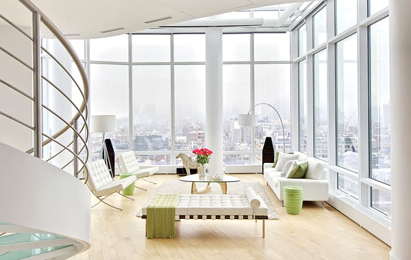 New York duplex penthouse with wood floors, white sofas and an amazing view of the city