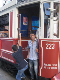 Kids riding the Heritage Tram on Istiklal Caddesi.