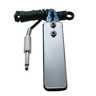 Narrow Stainless Steel Tattoo Foot Switch Pedal, possible to use for computer and game accessibility. Via OneSwitch.