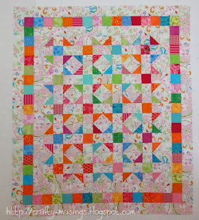 Floating Triangle leftovers quilt top