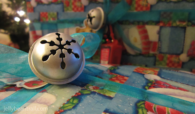 Decorate presents with jingle bells.