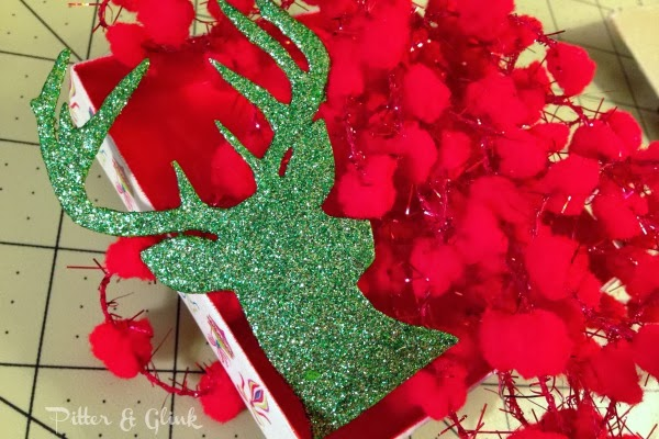 Create a Deer Silhouette Ornament from a recycled gift box using this tutorial from Pitter & Glink! #DIYOrnament #Christmascraft