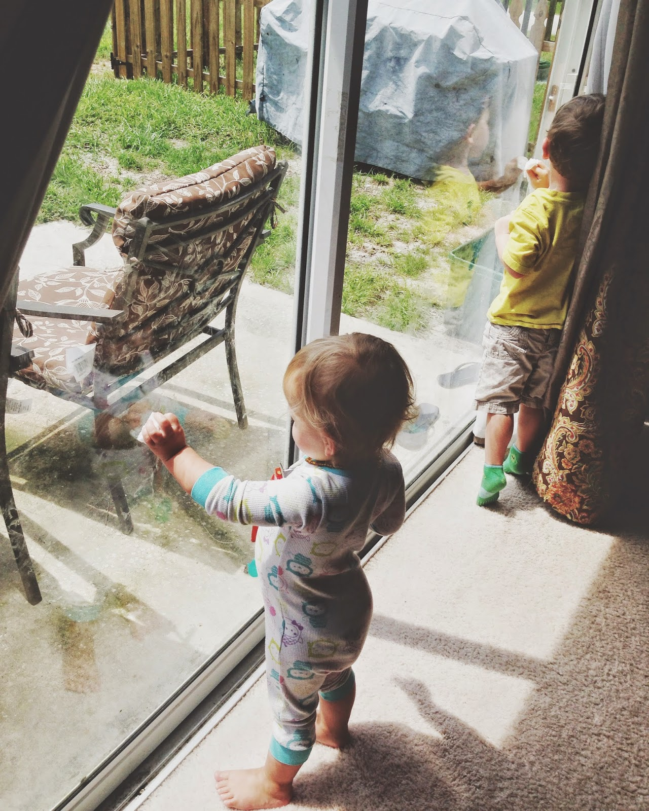 kids in pyjamas pjs at a window