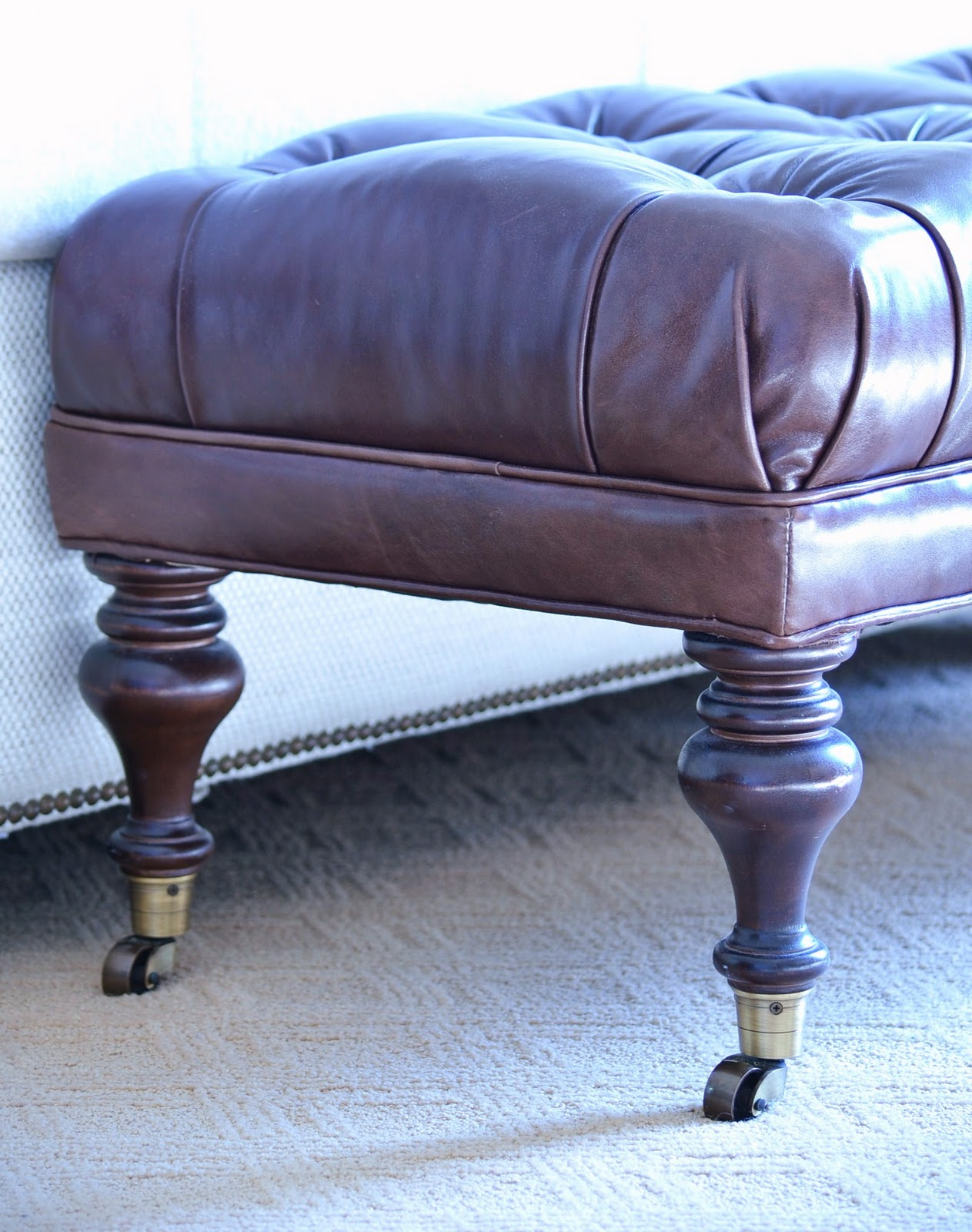 Acanthus and acorn sit on your tuffet for Ottoman to sit on