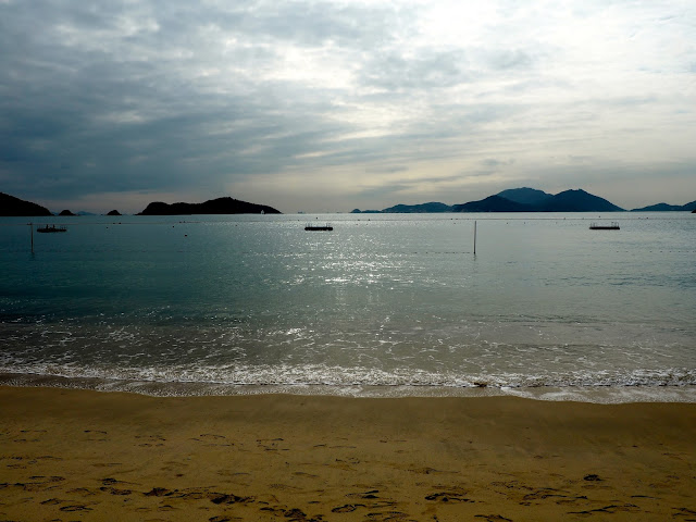Sand and ocean in the sun on Repulse Bay Beach, Hong Kong
