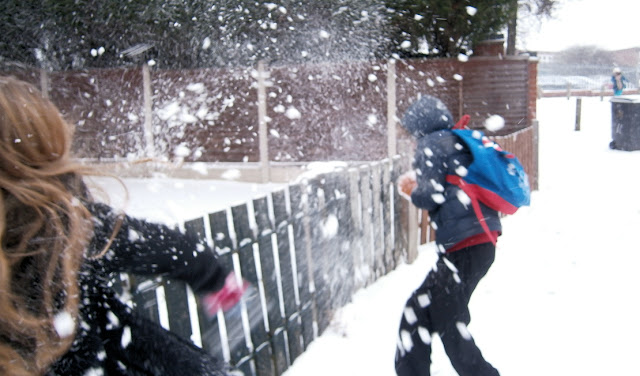 snowball fights action shot children playing