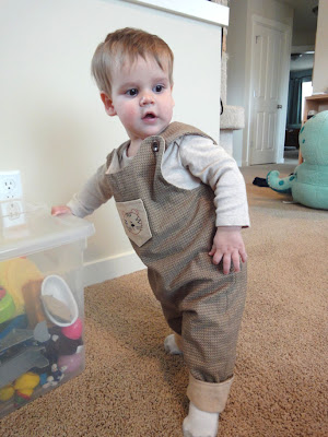 LB standing in his new overalls